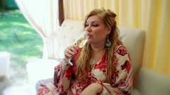 Secular female drinking champagne at the gala holiday buffet Stock Footage