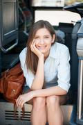 Cheerful young woman is ready for her journey Stock Photos