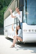 Cute young loving couple begins their journey - stock photo