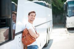 Attractive young guy is ready for his journey - stock photo