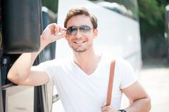 Handsome young guy is traveling by public transport Stock Photos