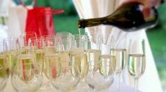 Secular festive gala celebratory buffet, drinks poured into glasses Stock Footage