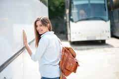 Stock Photo of Attractive young woman is traveling by public transport