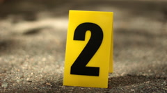 Cinematic Closeup of Yellow Crime Scene Marker Stock Footage