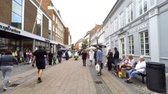 Police on bikes in a pedestrian street - Tour of Denmark Stock Footage