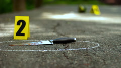 Cinematic Shot of Bloody Knife at Crime Scene Stock Footage
