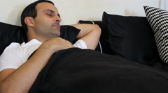 Man tossing and turning in bed Stock Footage