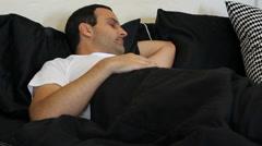 Man sleeping in bed - stock footage
