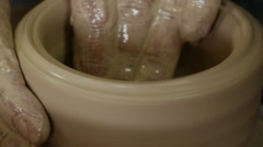 Potter Craftsman's Hands Are Moulding a Pot on Pottery Wheel Close Up Clay Pot Stock Footage