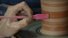 Potter Female Craftsman is Glazing Painting a Pot Rotating on Pottery Wheel Stock Footage