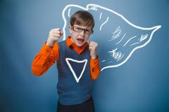 European-looking boy of ten years in glasses, anger, opened his Stock Photos