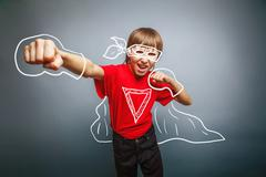 European-looking boy of ten years shows a fist, anger, danger - stock photo