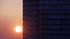 Sunrise behind highrise in Yokohama Stock Footage