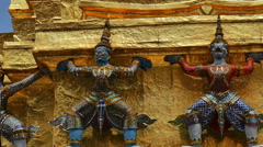Panning video of warrior statues at the temple Wat Phra Kaeo Stock Footage