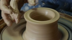 Potter Craftsman is Teaching a Woman to Work on Pottery Wheel Holding Her Hand Stock Footage