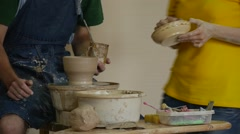 Male Potter Craftsman is Making a Clay Souvenir Working on Pottery Wheel Stock Footage