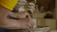 Two Potters Craftsmen are Working on Pottery Wheel Moulding a Clay Pot Making a - stock footage