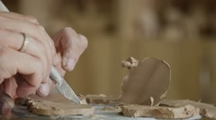 Craftsman is Making a Clay Souvenir Sculpting a Shape from Clay by Knife Hands Stock Footage