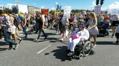 Marchers in wheelchairs at Gay pride parade in Stockholm Stock Footage
