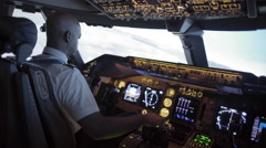 Over the shoulder of African-American pilot banking 747 4K Stock Footage