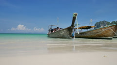 Tourist boat sails away from the tropical beach Stock Footage