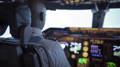 Over the shoulder of African-American pilot flying jumbo jet 4K - stock footage
