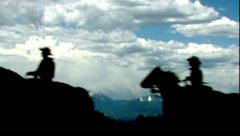 COWBOYS HERDING HORSES AND RUNNING WITH GREAT ACTION IN THE ROCKY MOUNTAINS Stock Footage