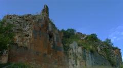 Derelict and Broken Overgrown Wall - stock footage