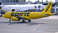 Stock Video Footage of Spirit Airlines yellow taxi cab plane