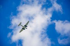 American military transport plane on the blue sky, Germany - stock photo