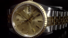 Extreme Close Up of Rolex Oyster Perpetual Date 18ct Gold watch. 4K UHD. - stock footage