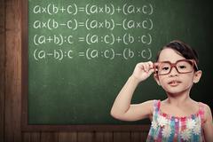 Little Girl With Math Formulas Stock Photos