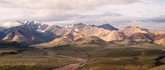 Puffy clouds blue sky Alaska Range Denali National Park - stock photo