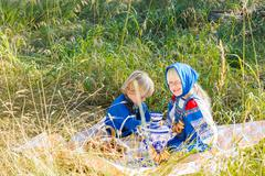 Russian children in traditional Russian costumes playing in the forest Stock Photos