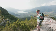 Hiker Navigates a Scenic Trail with a GPS Stock Footage