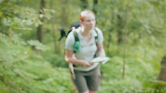 Woman Navigating a Trail with a Map Stock Footage