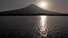 Sun is rising behind Mt. Fuji Stock Footage