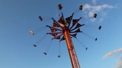 Fair ride shot against blue sky Stock Footage