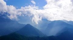 Clouds vaporising from mountain peaks. Sapa, Vietnam. 4K resolution speed up Stock Footage