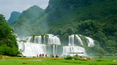 Ban Gioc Waterfall with visitors. Speed up. Vietnam Stock Footage