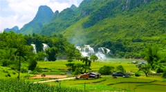 Ban Gioc Waterfall in lush green valley with rice fields. 4K resolution. Vietnam Stock Footage