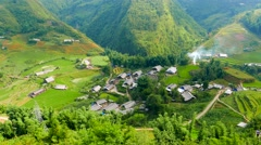 View of valley with green rice terraces and village. Sapa, Vietnam, 4K Stock Footage