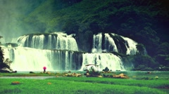 Ban Gioc Waterfall with visitor. Retro look. Vietnam Stock Footage