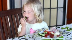 Stock Video Footage of Sweet little blonde girl having lunch