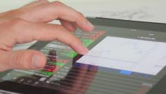 4K Businessman With Financial Stock Market Trading Graphs On Tablet - stock footage