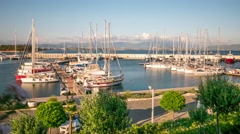 Sailing boats and yachts in a marina in a windy summer day. Time lapse, 4k Stock Footage