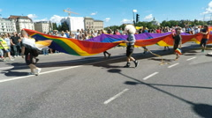 Massive rainbow flag at Gay pride parade in Stockholm Stock Footage