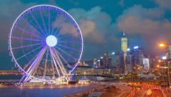 4k timelapse video of skycrapers and ferris wheel in Hong Kong Stock Footage