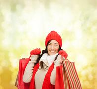 Smiling woman in warm clothers with shopping bags Stock Photos