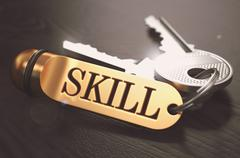 Skill - Bunch of Keys with Text on Golden Keychain - stock illustration